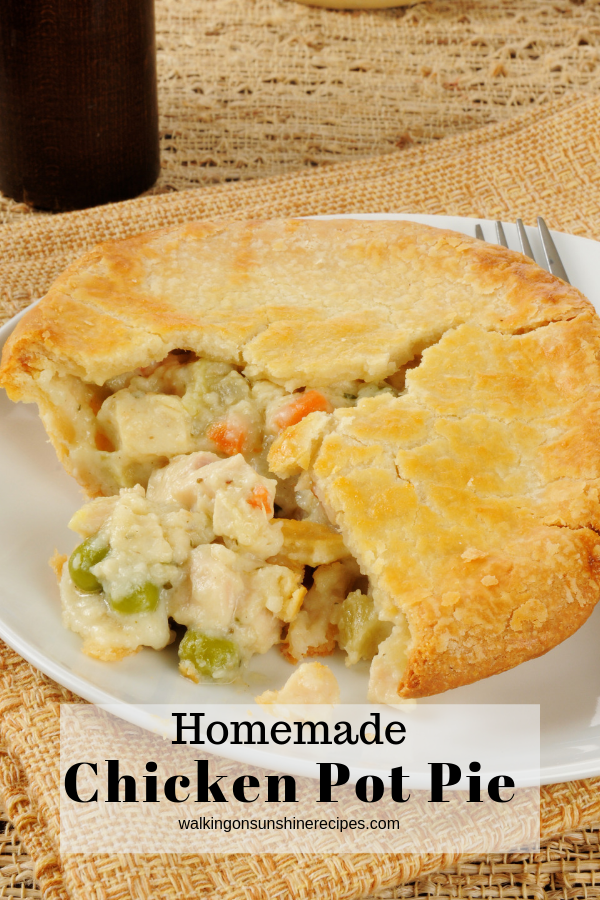Individual chicken pot pie on white plate.