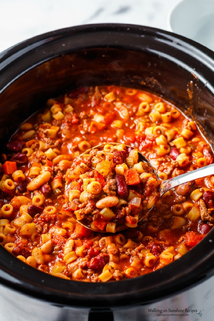 Pasta Fagioli Soup in Crock Pot cooked and ready to serve with soup ladle.