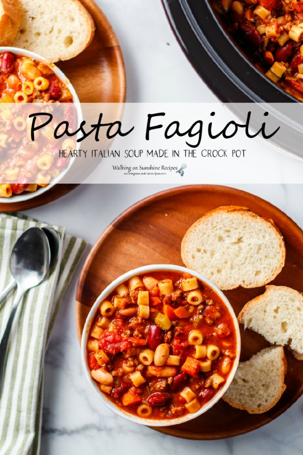 Pasta Fagioli Soup and fresh baked bread on wooden board.