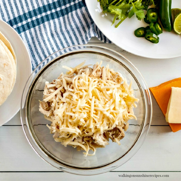 Combine chicken and cheese together in bowl.