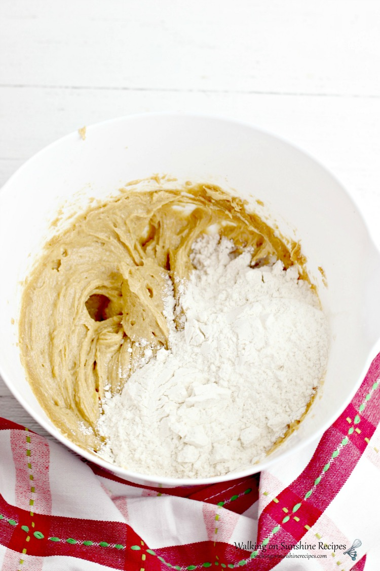Add flour to creamed butter mixture