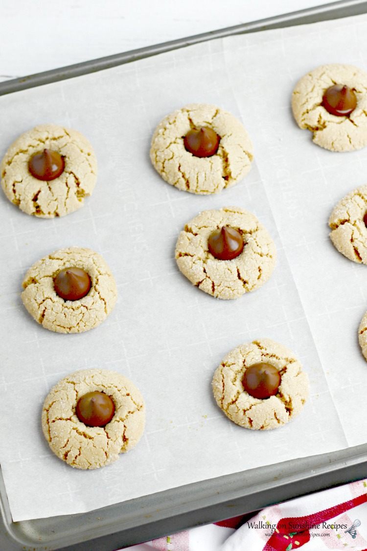 Peanut Butter Blossoms baked on tray