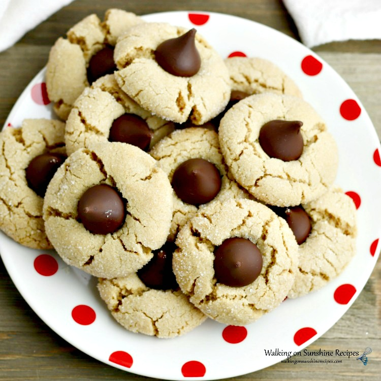 Peanut Butter Blossoms on white plate with red dots