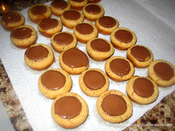 Peanut Butter Blossom Cookies with Reese's Peanut Butter Cups from Walking on Sunshine Recipes.