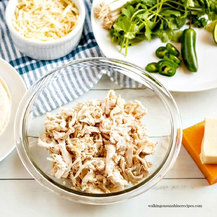 shredded chicken for creamy chicken enchiladas.