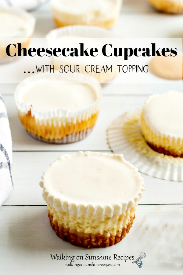 Cheesecake Cupcakes with Sour Cream Topping on wooden board