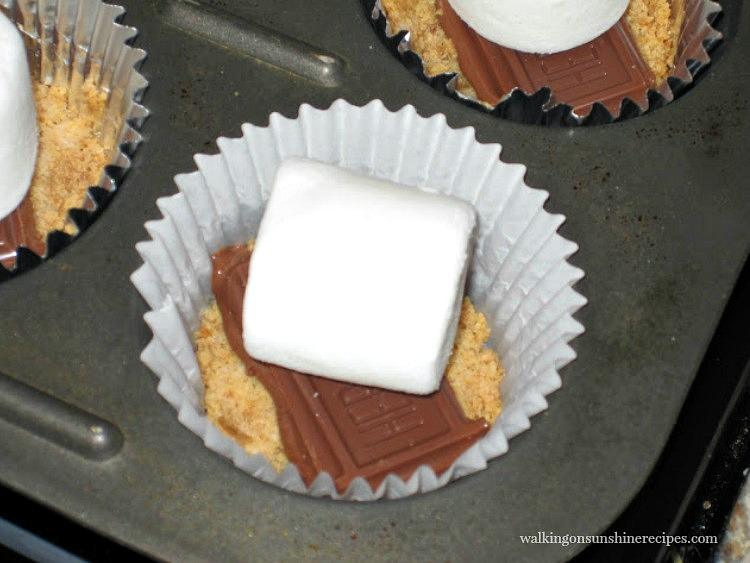 Add the Marshmallow on top of the Chocolate for S'more's Cookie Cups from Walking on Sunshine Recipes