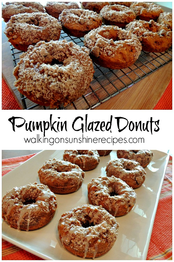 pumpkin donuts with crumb topping on cooling rack and on white tray.