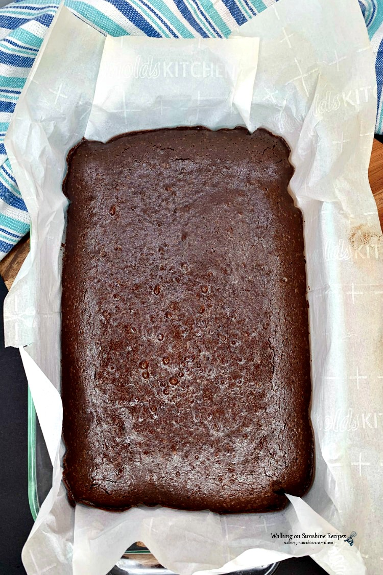 Homemade Brownies with Coffee in the Batter Baked in pan with parchment paper.
