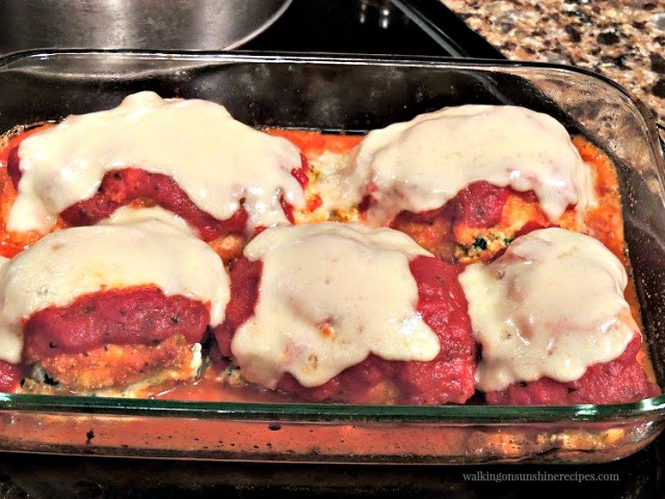 Chicken Breasts stuffed with ricotta cheese and spinach with marinara sauce and mozzarella cheese baked