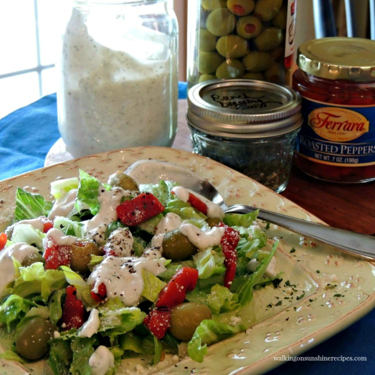 Homemade Ranch Salad Dressing served over lettuce, cucumbers, olives and red pepper slices.
