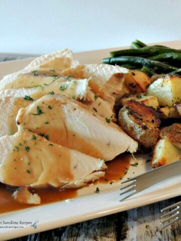 Crock Pot Turkey Breast on white platter