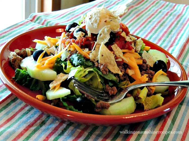 Taco Salad on red plate with Homemade Taco Seasoning