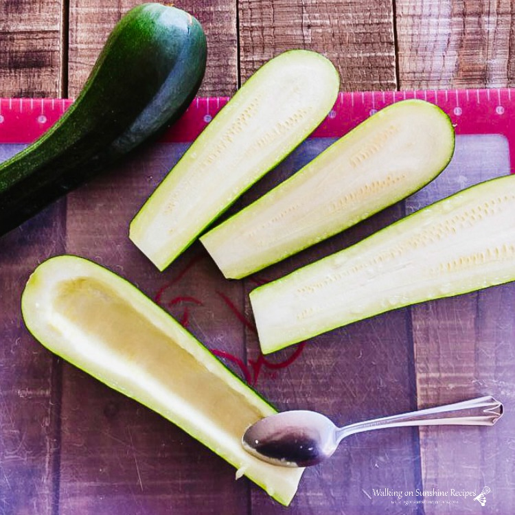 Use a spoon to hollow out zucchini