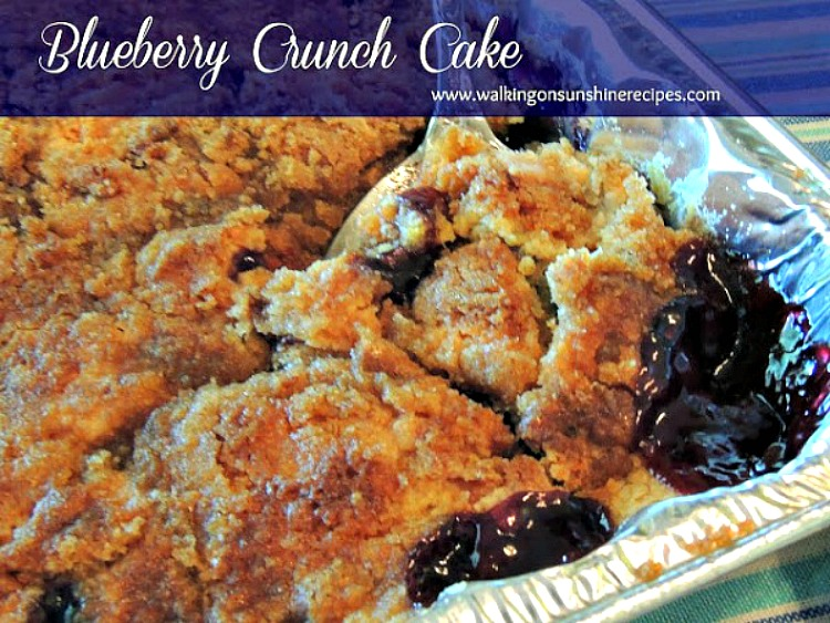 Blueberry Crunch Cake or Blueberry Dump Cake Recipe closeup in baking dish with spoon.