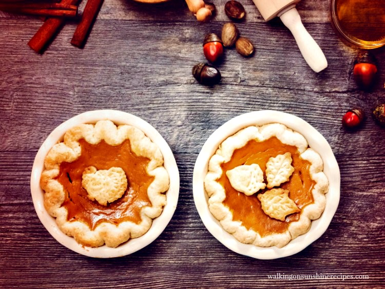 Decorated Pumpkin Pies with leaf and turkey pie cut outs from Walking on Sunshine Recipes