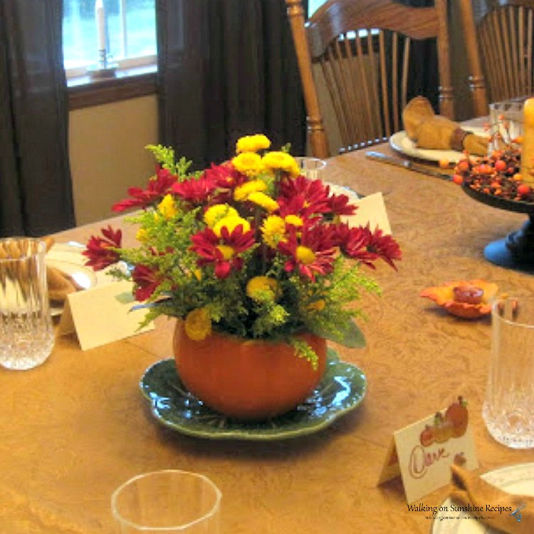 Real pumpkin as Thanksgiving centerpiece with fresh flowers.