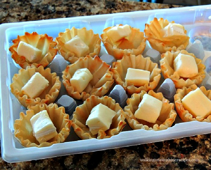 Place a small cube of brie cheese inside each phyllo cup.