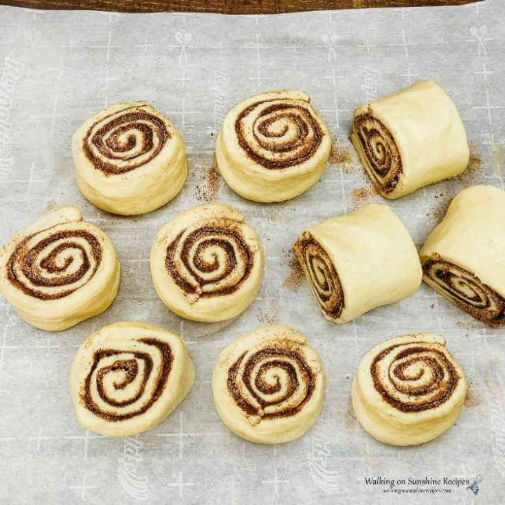 Homemade Cinnamon Rolls Sliced on Parchment Paper from WOS