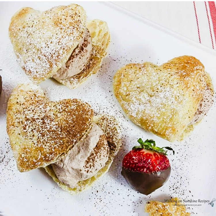 Puff pastry cut into heart shapes filled with chocolate mousse.