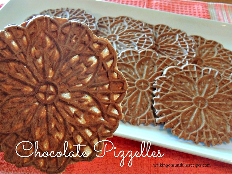 Closeup of Chocolate Pizzelles on white plate.