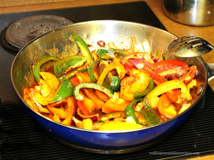 Onions and Peppers cooked in frying pan