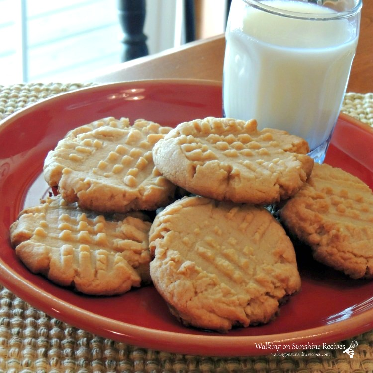 Peanut Butter Cookies with glass of milk on red plate. Cookies made from Cake Mix