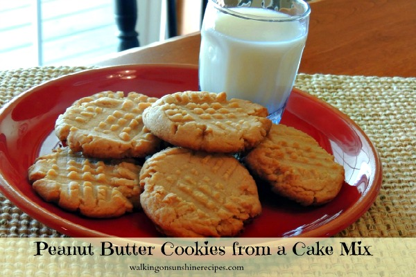 Peanut Butter Cookies from a Cake Mix on a red plate with a glass of milk from Walking on Sunshine.