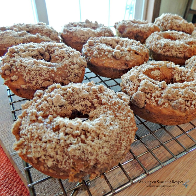 Closeup of Pumpkin Crumb Donuts on wire rack before adding glaze from Walking on Sunshine Recipes
