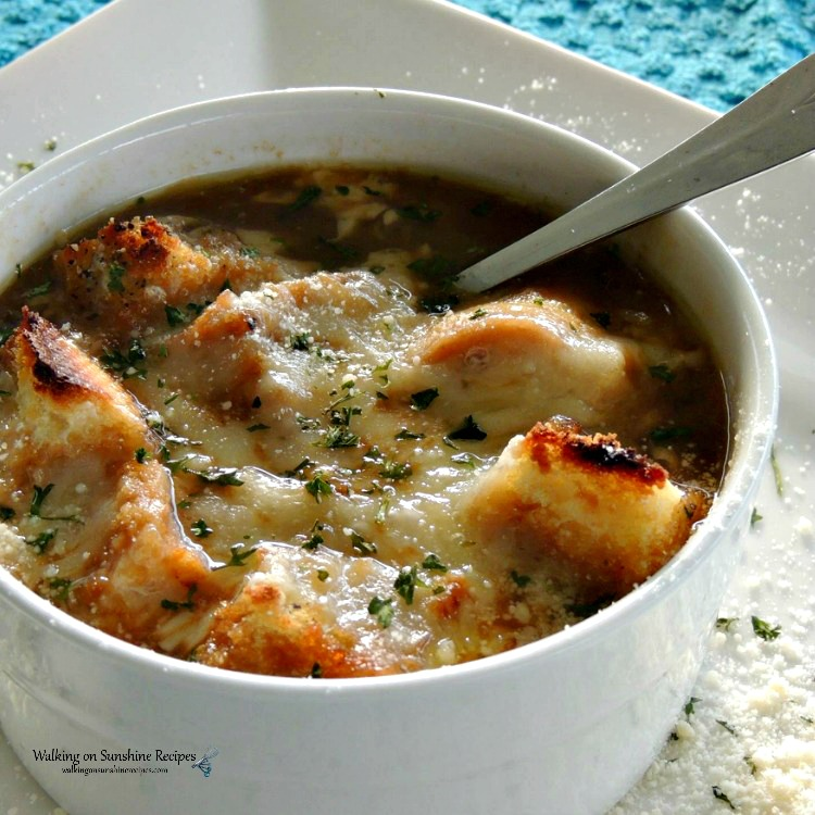 Easy French Onion Soup with Homemade Croutons served in white bowl.