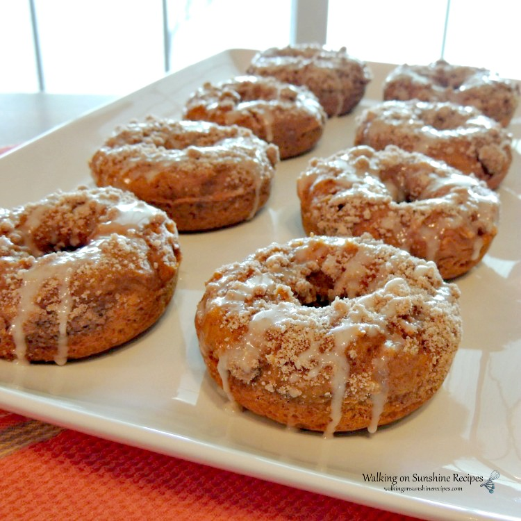 Pumpkin Glazed Donuts with Crumb Topping on white tray