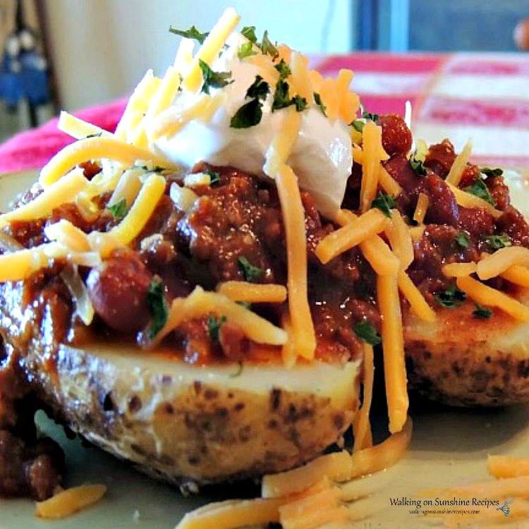 Leftover chili served over baked potatoes.