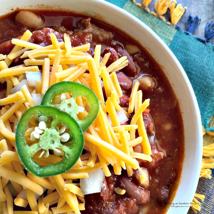 Crock Pot Chili made with ground beef, red kidney beans, cheddar cheese and jalapenos.