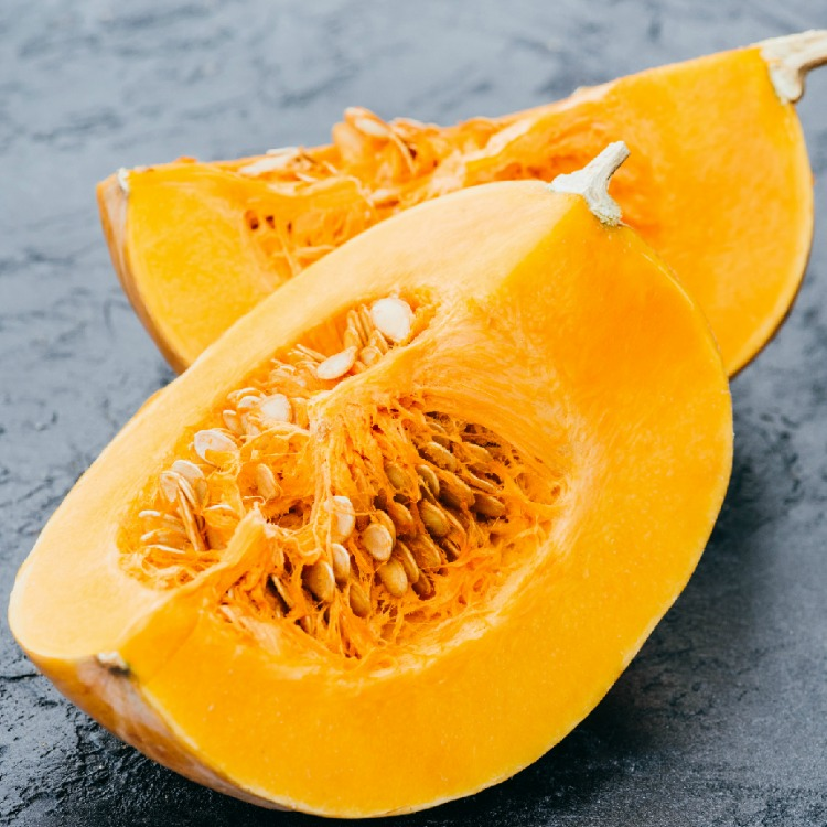 Cut open pumpkin with seeds from WOS