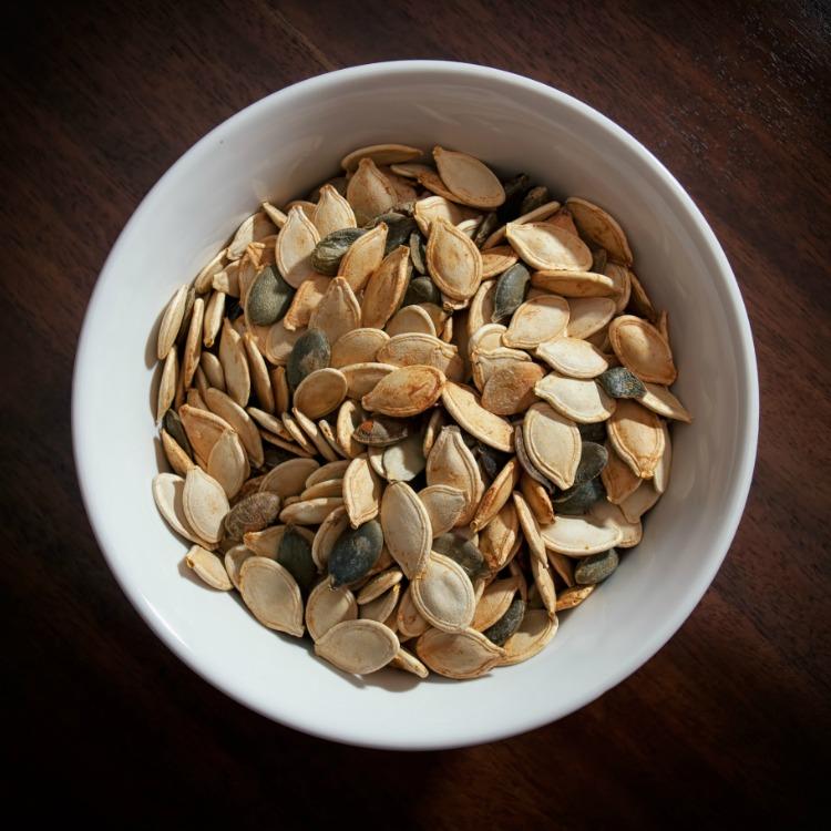 Pumpkin Seeds in white bowl