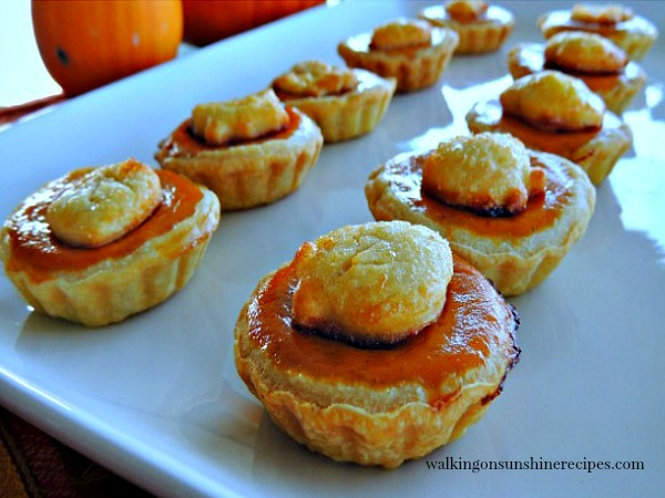 Mini Pumpkin Pie Treats on white tray make the perfect dessert for Thanksgiving or any fall gathering from Walking on Sunshine Recipes.