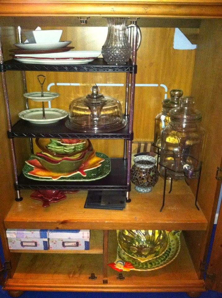 I purchased a shelving unit and relocated all my oversized serving dishes, bowls and beverage containers to one place.