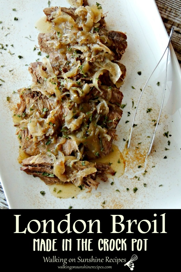 London broil crock pot on white platter with onions.