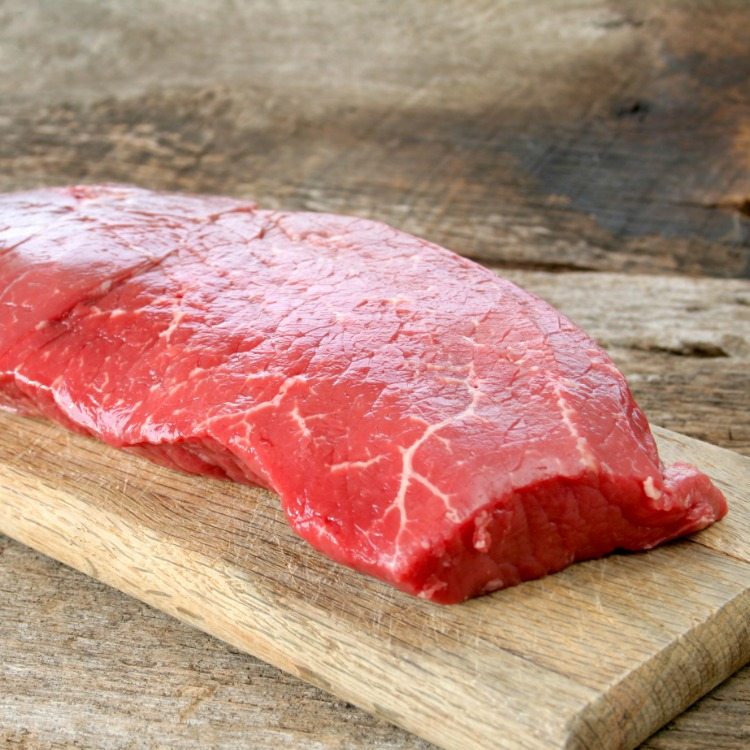 Raw London Broil on Wooden Cutting Board