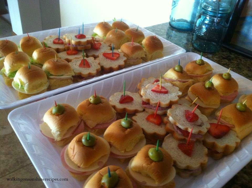 ham and cheese sandwiches with olives on top again i used a small round biscuit cutter so the slices of turkey and cheese fit nicely on the soft rolls
