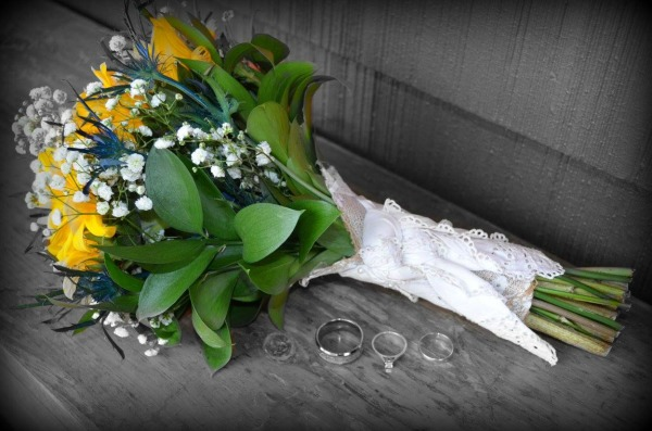 I had the florist incorporate one of my grandmother's handkerchiefs into the bride's bouquet from Walking on Sunshine Blog.