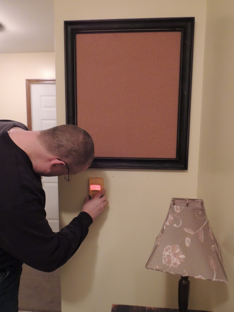 Finding the studs to hang the DIY Industrial Style Message Center from Walking on Sunshine.