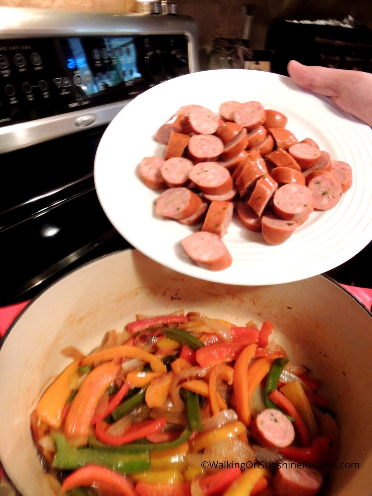 Add sausage to cooked peppers and onions.