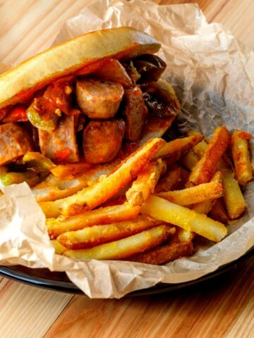 sausage and peppers with French Fries.