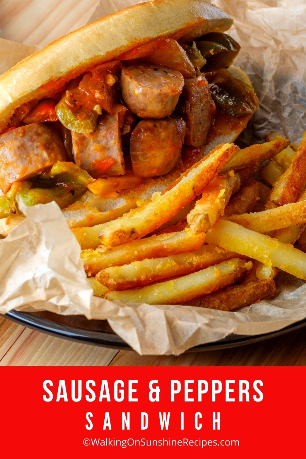 Sausage and Peppers Sandwich with French Fries.