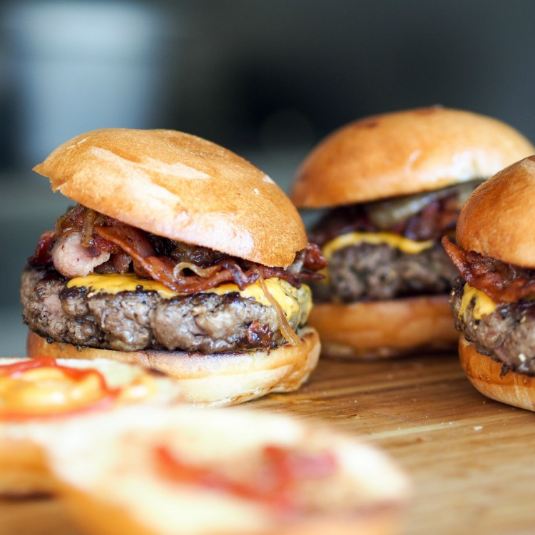 Hamburgers with bacon and cheese