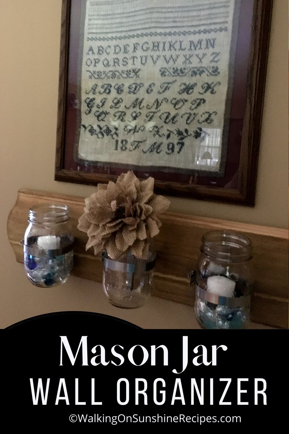 Mason Jar Wall Organizer Pin 1 with candles and yellow flowers.