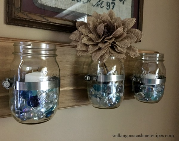 Mason Jar Organizer filled with candles and a burlap flower.