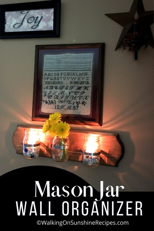 mason jar attached to wood organizer pin.