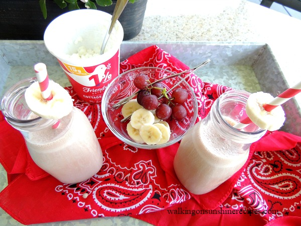 Chocolate banana smoothie with grapes and cottage cheese.